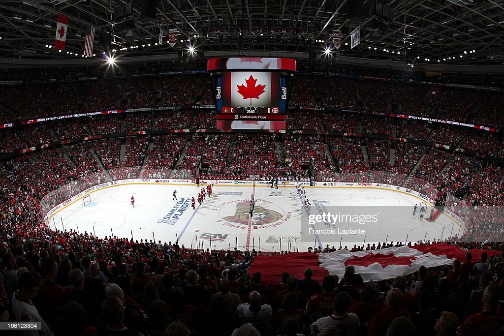 The Canadian flag appears over the crowd during the national anthem at Scotiabank Place prior to the game between the Ottawa Senators and the Montreal Canadiens in Game Three of the Eastern Conference Quarterfinals during the 2013 NHL Stanley Cup Playoffs at Scotiabank Place on May 5, 2013 in Ottawa, Ontario, Canada.