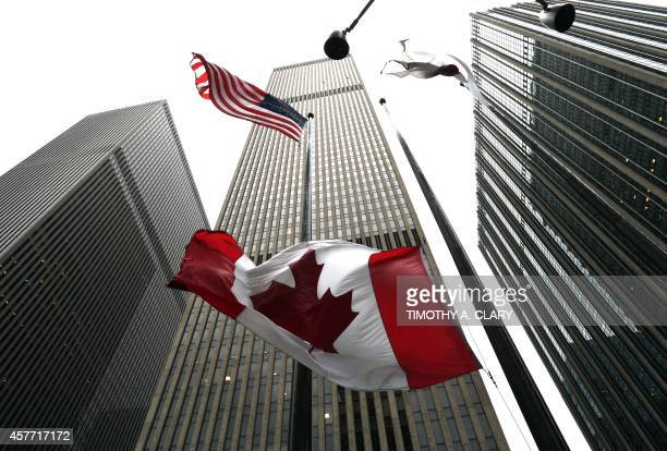 The Canadian flag flies at halfmast at the Consulate General of Canada in New York October 23 2014 Canada's Prime Minister Stephen Harper vowed the...