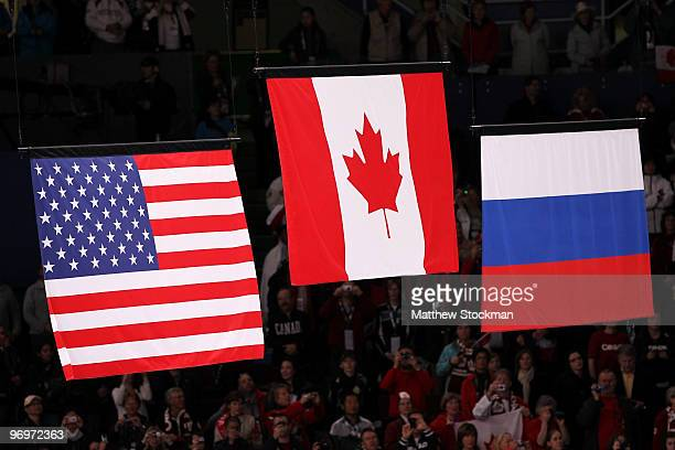 The Canadian flag flies high above those of the USA and Russia after Tessa Virtue and Scott Moir of Canada win gold in the Ice Dance competition on...