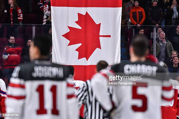The Canadian flag is raised after Team Canada's victory over Team Czech Republic during the 2017 IIHF World Junior Championship quarterfinal game at...