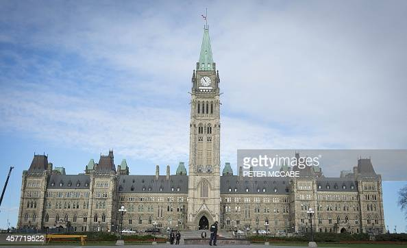The Canadian Parliament is seen on October 23 in Ottawa the day after multiple shootings in the capital city and Parliament buildings left a soldier...