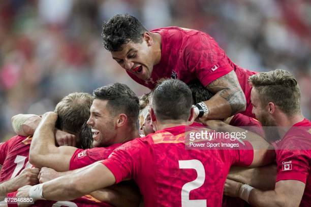 The Canadian team celebrates winning the match United States vs Canada the Cup Final of the HSBC Singapore Rugby Sevens as part of the World Rugby...