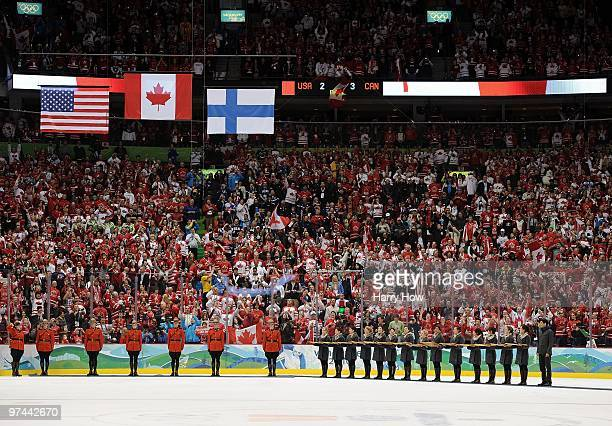 The Canadian USA and Finland flags are raised during the medal ceremony after the ice hockey men's gold medal game between USA and Canada on day 17...