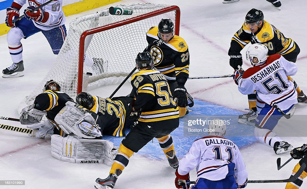 The Canadiens' David Desharnais (#51) beats the Bruins' Tuuka Rask after a free for all in front of the net to put Montreal ahead 4-3 in the third period as the Boston Bruins hosted the Montreal Canadiens in a regular season NHL hockey game at the TD Garden.
