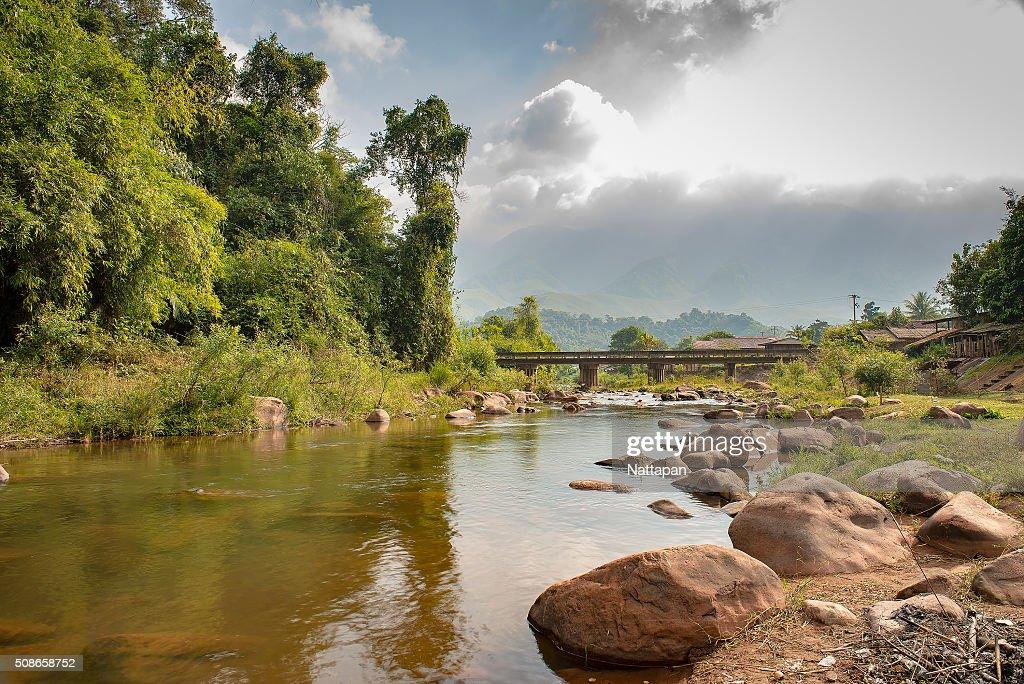 The canal and bridge at Bo Kluea district , Nan Thailand : Stock Photo