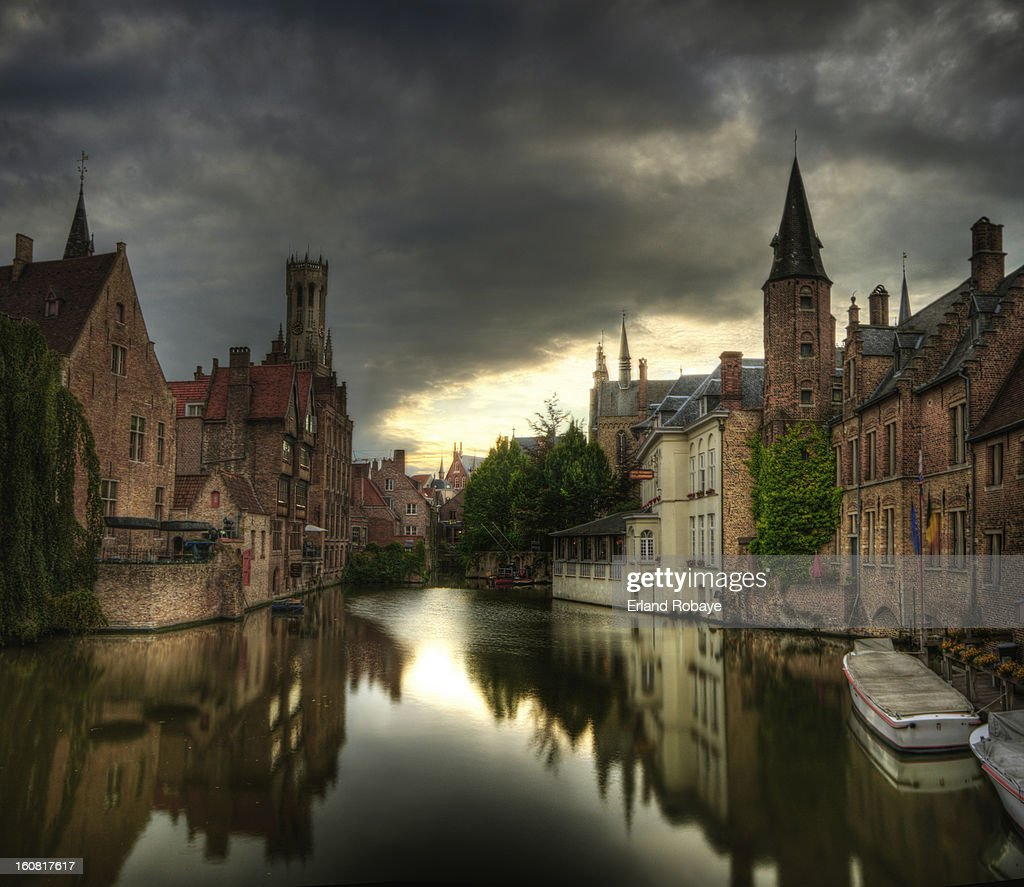 CONTENT] The canals in the medieval town of Bruges, dramatic clouds and beautiful reflection and a look towards the Belfry.