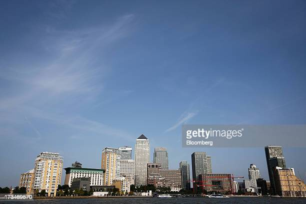 The Canary Wharf business and shopping district stands on the River Thames in London UK on Friday July 12 2013 Recent data suggest Britain's economic...