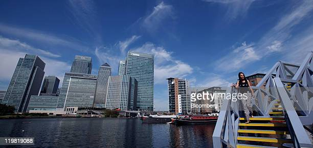 The Canary Wharf business district is seen in London UK on Monday July 25 2011 Greece's credit rating was cut three steps by Moody's Investors...