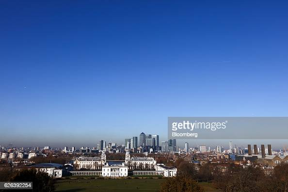 The Canary Wharf business financial and shopping district stands beyond the National Maritime Museum and the Old Royal Naval College in London UK on...