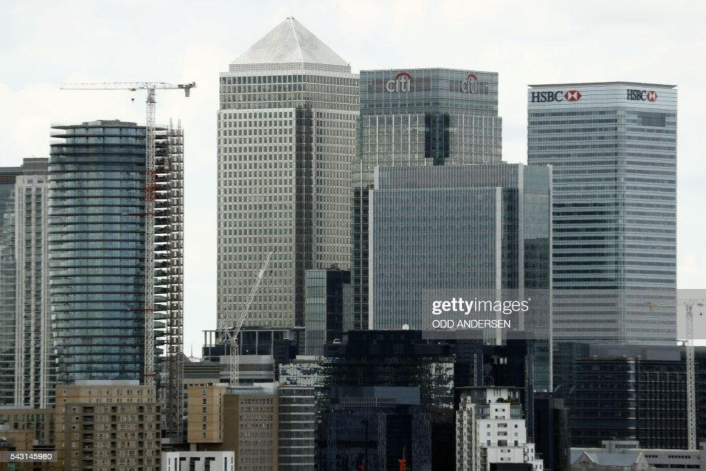 The Canary Wharf finance district of London, encompasing the offices of HSBC, Citigroup, JPMorgan Chase, and other global banking corporations, is pitcured from Greenwich park in south-east London on June 26, 2016. British business minister Sajid Javid on Sunday urged companies not to panic following Britain's vote to leave the European Union (EU) despite dire warnings of the economic consequences of the Brexit vote. 'Our economic fundamentals remain strong. They're strong enough to weather any short-term market volatility,' he said, after Thursday's vote plunged global financial markets and the value of the pound. / AFP / ODD