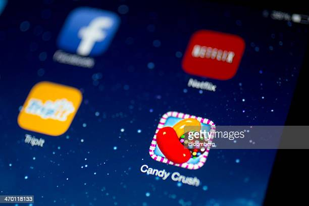 The 'Candy Crush Saga' application badge is displayed on an Apple Inc iPad Air in this arranged photograph in Washington DC US on Tuesday Feb 18 2014...
