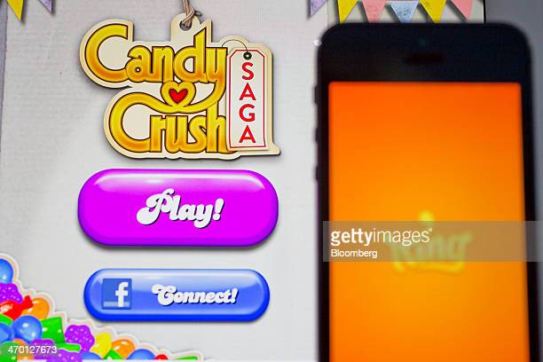 The 'Candy Crush Saga' game and King Digital Entertainment Plc logo are displayed on an Apple Inc iPad Air and iPhone 5s in this arranged photograph...