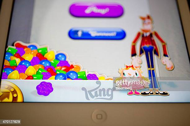 The 'Candy Crush Saga' game is displayed on an Apple Inc iPad Air in this arranged photograph in Washington DC US on Tuesday Feb 18 2014 King Digital...