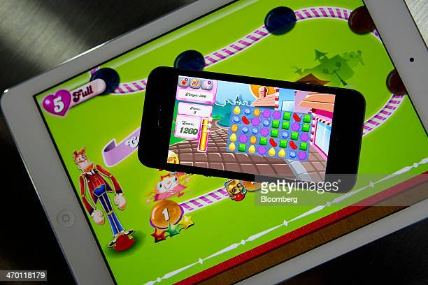 The 'Candy Crush Saga' game is displayed on an Apple Inc iPhone 5s and iPad Air in this arranged photograph in Washington DC US on Tuesday Feb 18...