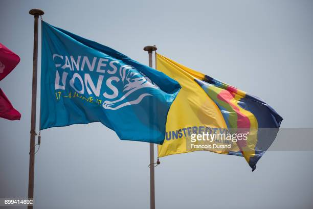The Cannes Lions flag flies next to the Unstereotype Alliance flag over the Palais of the Cannes Lions International Festival of Creativity...