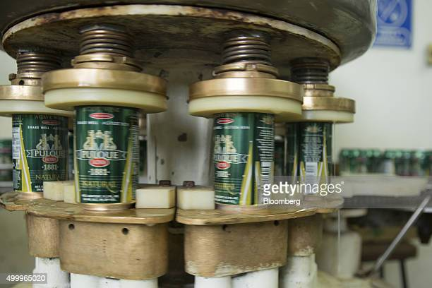 The canning machine operates at the Del Razo family's Rancho San Isidro farm and pulque production facility in Nanacamilpa Mexico on Thursday Dec 3...