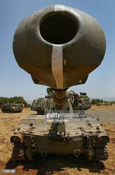 The cannon of an Israeli army 155mm mobile artillery piece points towards Lebanon as a battery of Israel's heavy guns deploys August 11 2003 in the...