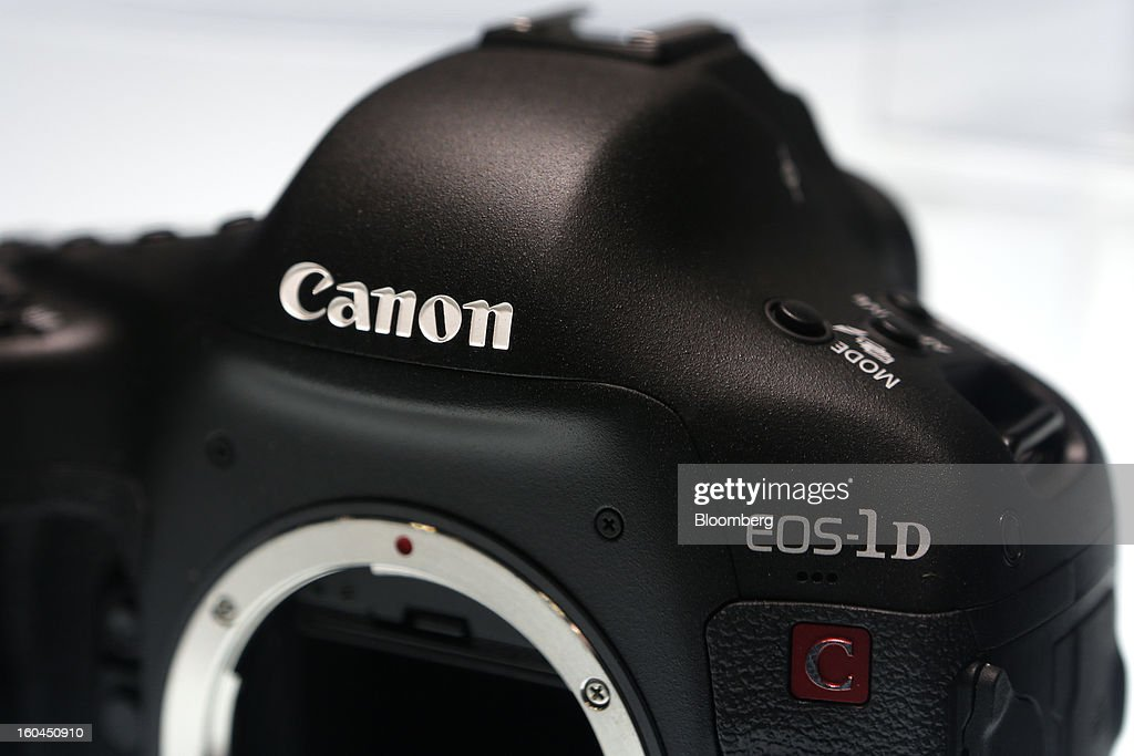 The Canon Inc. EOS-1D C digital single lens reflex (DSLR) camera sits on display at the CP+ Camera and Photo Imaging Show in Yokohama City, Japan, on Thursday, Jan. 31, 2013. The CP+ Camera and Photo Imaging Show runs from Jan. 31 to Feb. 3. Photographer: Kiyoshi Ota/Bloomberg via Getty Images