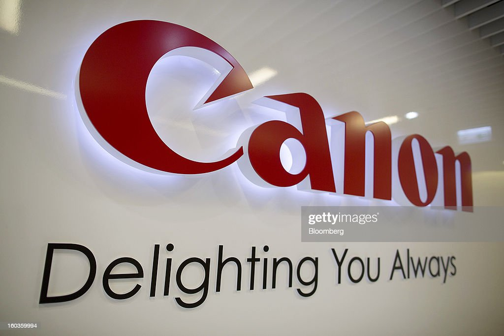 The Canon Inc. logo is displayed at the company's showroom in Hong Kong, China, on Tuesday, Jan. 29, 2013. Canon, the world's largest camera maker, forecast profit will rise 14 percent this year amid a weaker yen and the withering of a boycott of Japanese goods in China. Photographer: Jerome Favre/Bloomberg via Getty Images