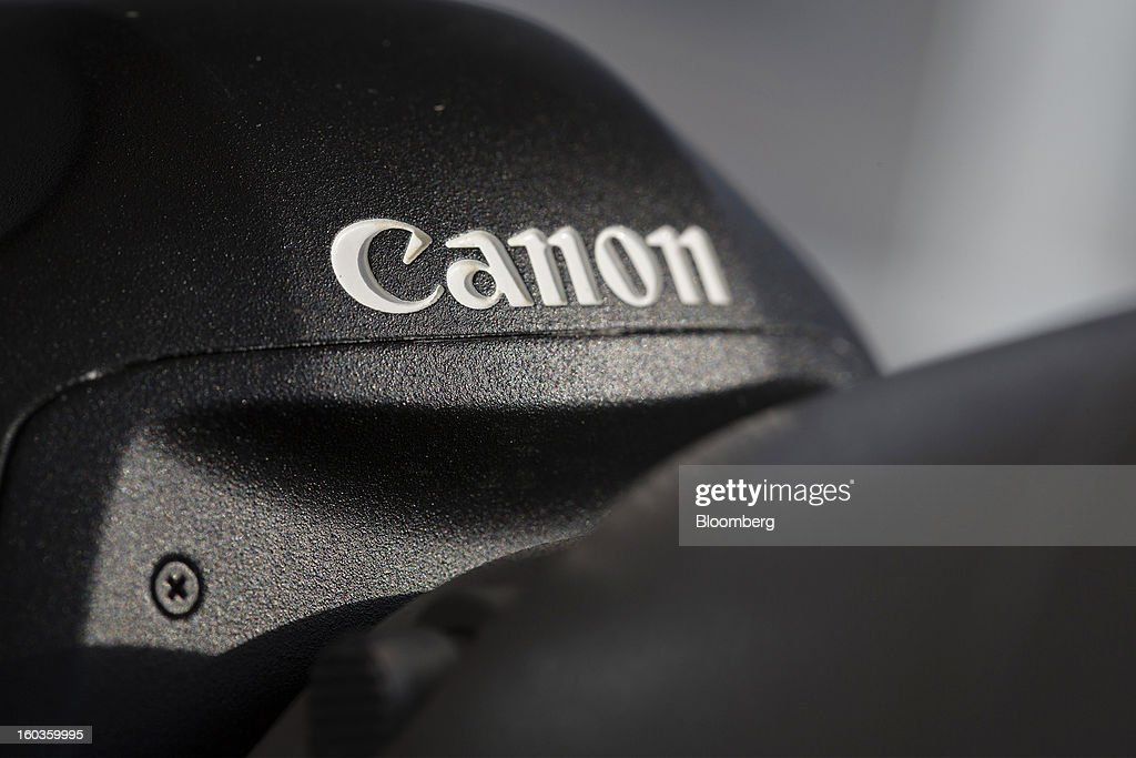 The Canon Inc. logo is displayed on a digital single lens reflex (SLR) camera at the company's showroom in Hong Kong, China, on Tuesday, Jan. 29, 2013. Canon, the world's largest camera maker, forecast profit will rise 14 percent this year amid a weaker yen and the withering of a boycott of Japanese goods in China. Photographer: Jerome Favre/Bloomberg via Getty Images