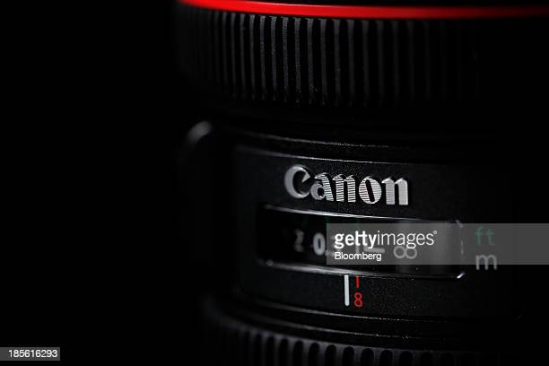 The Canon Inc logo is displayed on the company's EF 815mm F4L USM fisheye lens in this arranged photograph in Soka Saitama Prefecture Japan on...
