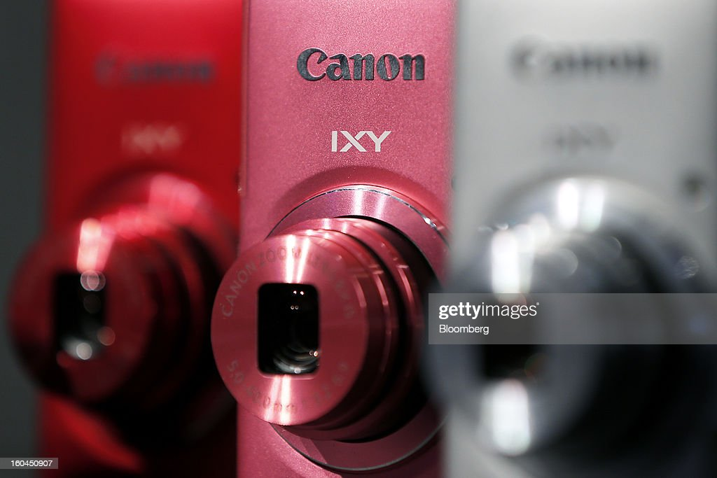 The Canon Inc. logo is seen on the IXY 110F compact digital camera displayed at the company's booth during the CP+ Camera and Photo Imaging Show in Yokohama City, Japan, on Thursday, Jan. 31, 2013. The CP+ Camera and Photo Imaging Show runs from Jan. 31 to Feb. 3. Photographer: Kiyoshi Ota/Bloomberg via Getty Images