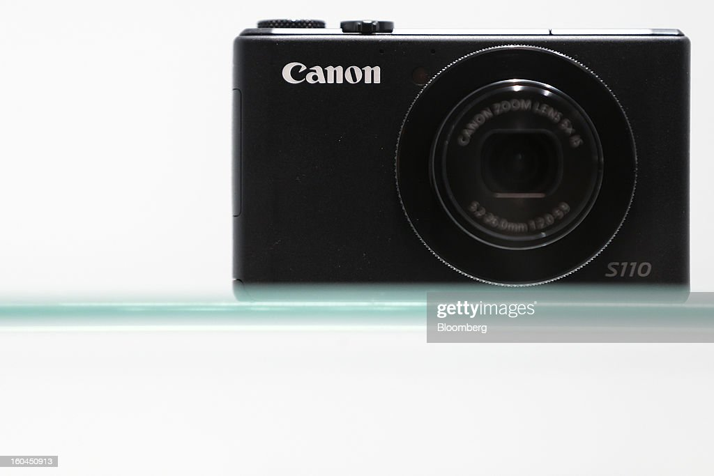 The Canon Inc. PowerShot S110 compact digital camera sits on display at the CP+ Camera and Photo Imaging Show in Yokohama City, Japan, on Thursday, Jan. 31, 2013. The CP+ Camera and Photo Imaging Show runs from Jan. 31 to Feb. 3. Photographer: Kiyoshi Ota/Bloomberg via Getty Images