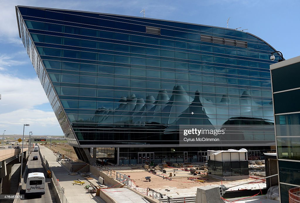 The canopy of the main terminal is reflected in the windows of the Westin Hotel at Denver International Airport on Monday June 1 2015 They showed off...