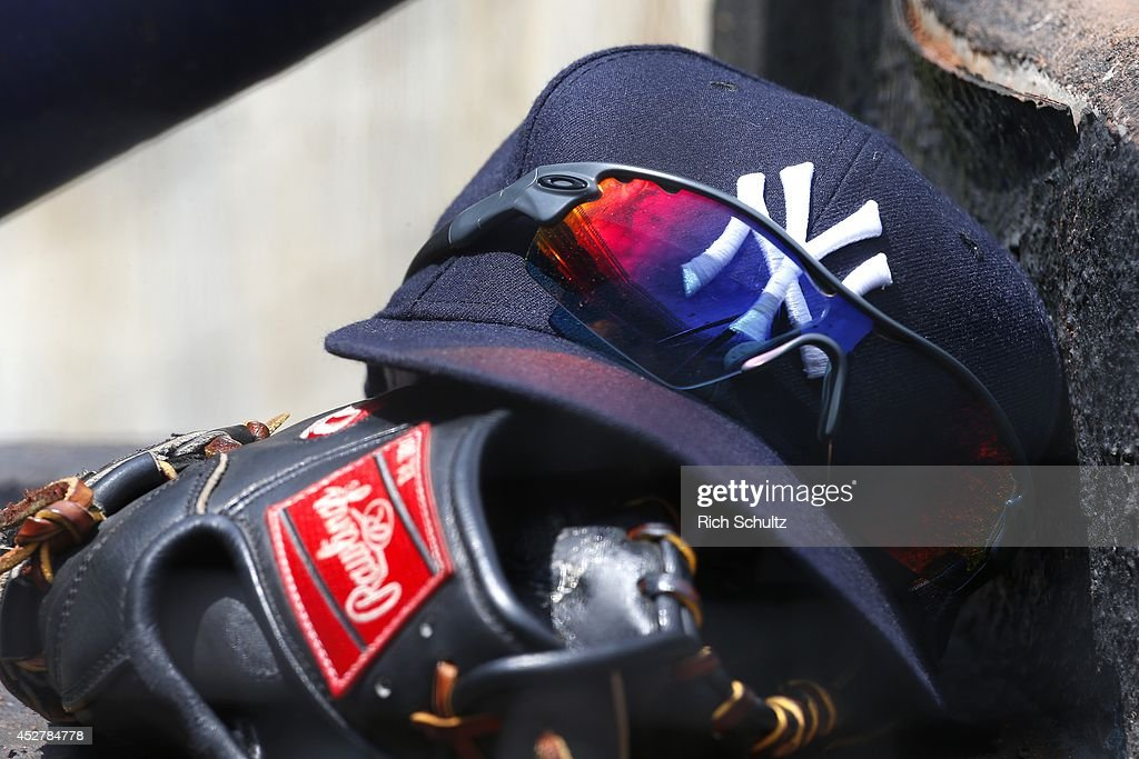 The cap, glove and glasses belonging to Derek Jeter #2 of the New York Yankees, sit on the dugout step during a game against the Toronto Blue Jays at Yankee Stadium on July 26, 2014 in the Bronx borough of New York City. The Blue Jays defeated the Yankees 6-4.