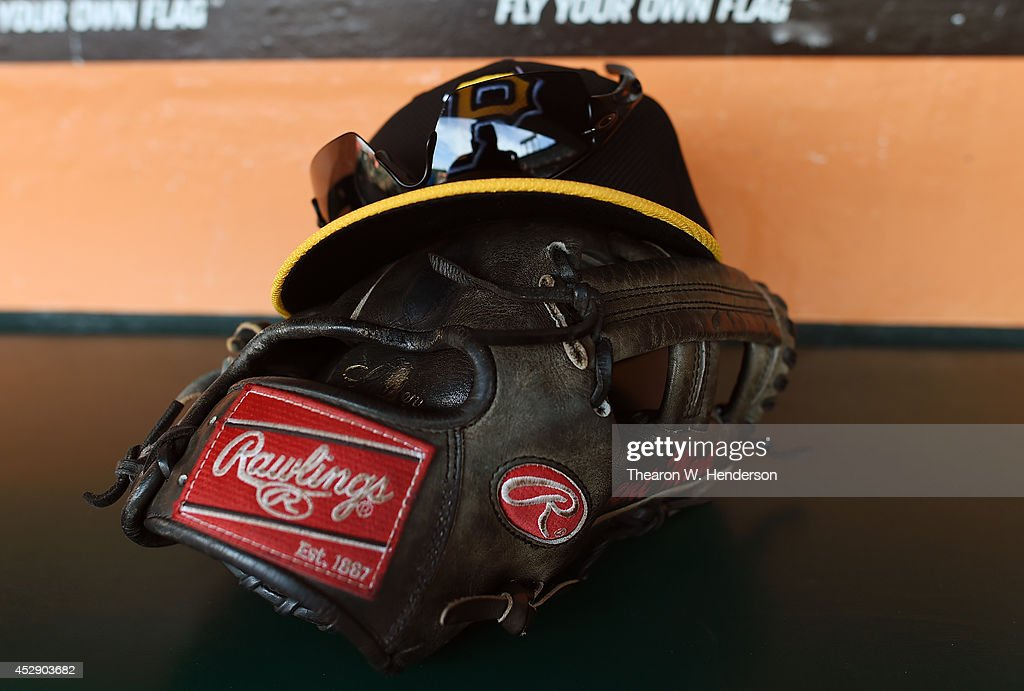 The Cap, Oakley Sunglasses and Rawlings baseball glove belonging to Brent Morel #59 of the Pittburgh Pirates sits in the dugout during batting practice prior to the game against the San Francisco Giants at AT&T Park on July 28, 2014 in San Francisco, California.