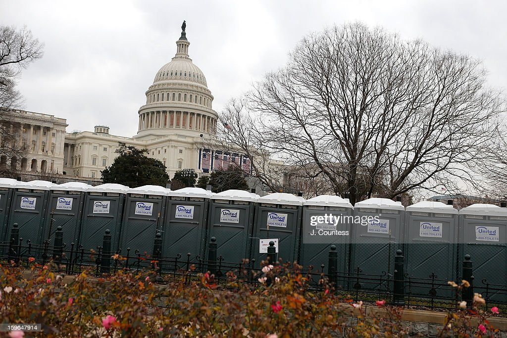 The Capitol Building is seen in the background behind rows of porta potties set up in preparation for the inauguration ceremony for President Barack Obama on January 17, 2013 in Washington, United States. The inauguration ceremony is to take place on January 21, 2013.