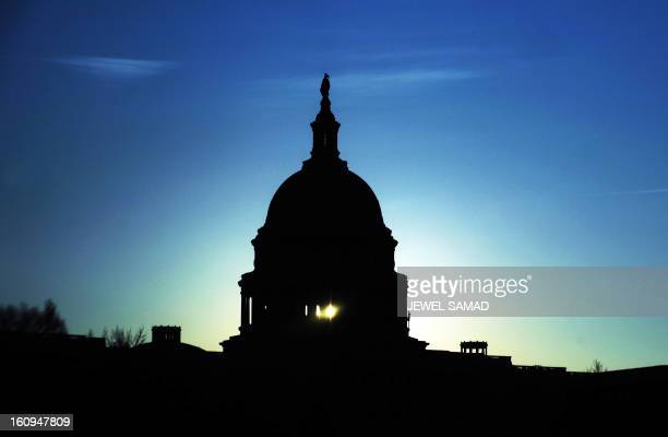 The Capitol dome is seen silhouetted against the rising sun in Washington DC on February 1 2010 US President Barack Obama's administration...