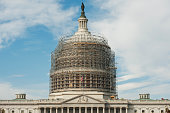 The Capitol dome is seen surrounded in scaffolding for a restoration project October 24 2014