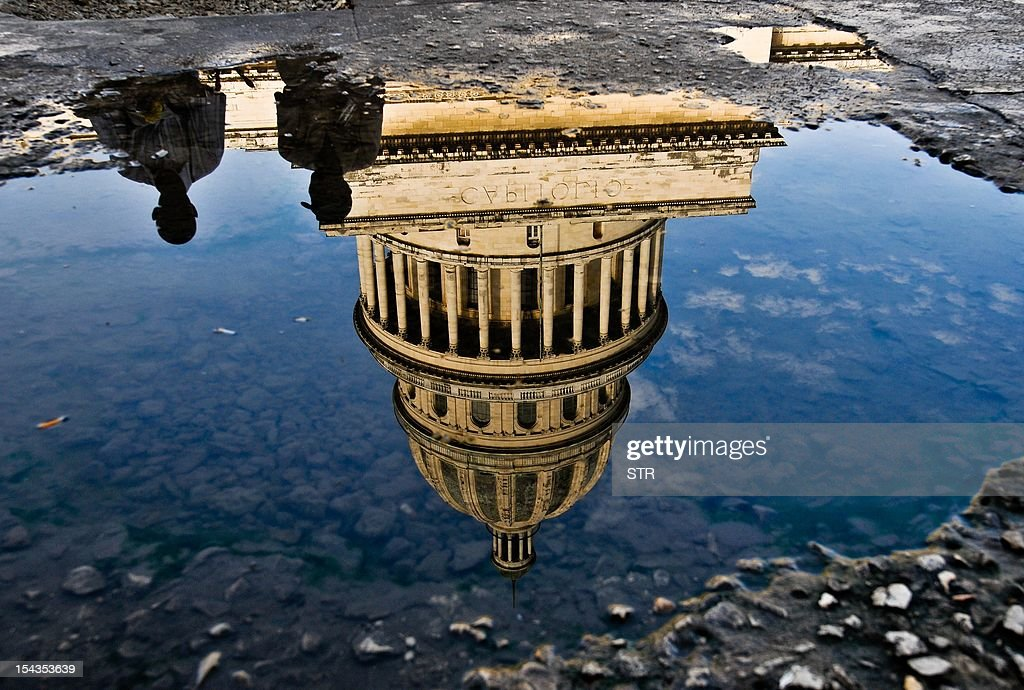The Capitol of Havana, a symbol of the legislative power before the Fidel Castro Revolution victory in 1959, reflected on a pool on October 18, 2012.