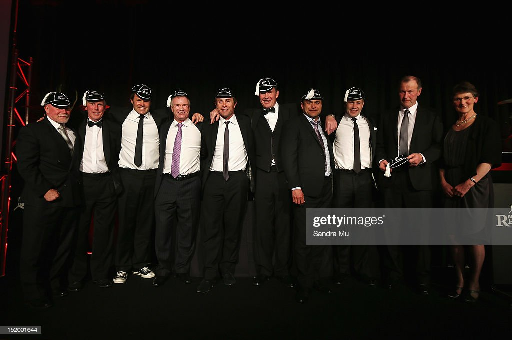 The capping recipients pose on stage during the New Zealand All Blacks reunion dinner on September 14, 2012 in Dunedin, New Zealand.