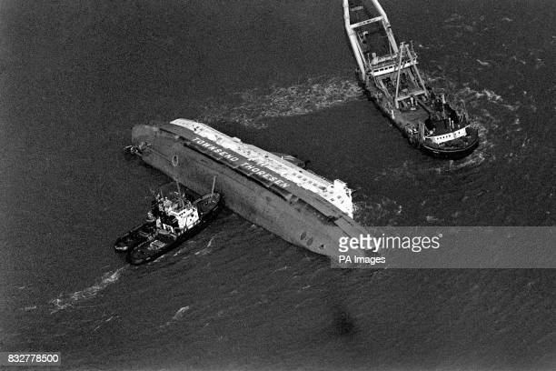 The capsized car ferry Herald of Free Enterprise on her side near the entrance to Zeebrugge port Belgium