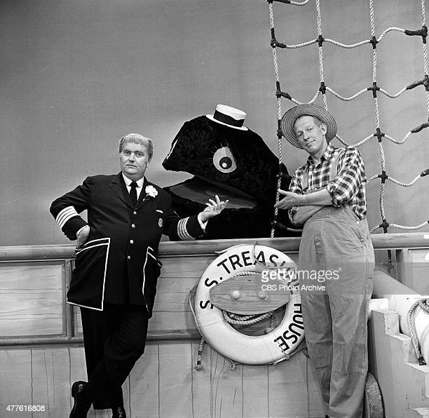 The CAPTAIN KANGAROO show Bob Keeshan left and Hugh Brannum as Mr Green Jeans with Cosmo Allegretti in the whale puppet Image dated August 6 1959