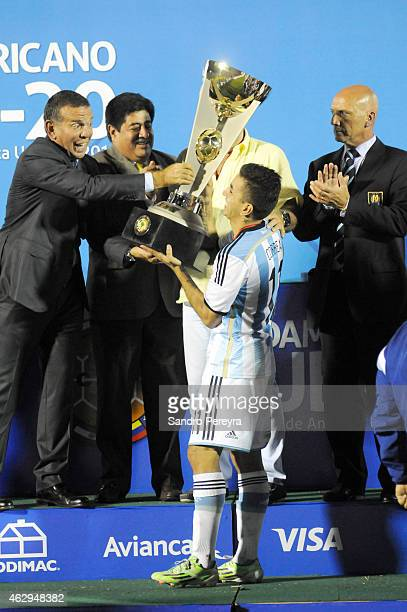 The captain of Argentina Angel Correa receives the trophy after a match between Argentina and Uruguay as part of South American U20 at Centenario...