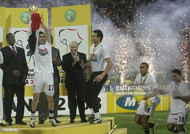 The captain of Egypt's national football team Ahmed Hassan holds up the trophy of the 2008 African Nations Cup as Confederation of African Football...