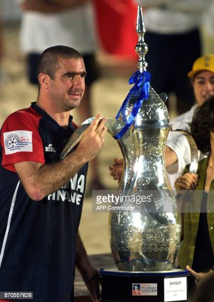 The captain of the French Beach Soccer team Eric Cantona raises the winner's trophy after the finals of the Dubai Pro Beach Soccer tournament 20...