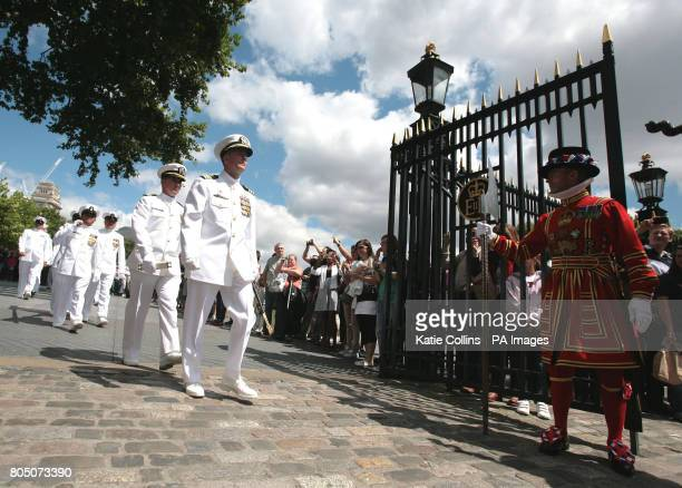 The captain of USS Halyburton Commander Michael P Huck leads his crew through the Tower of London West Gate after being allowed entry by the Yeoman...