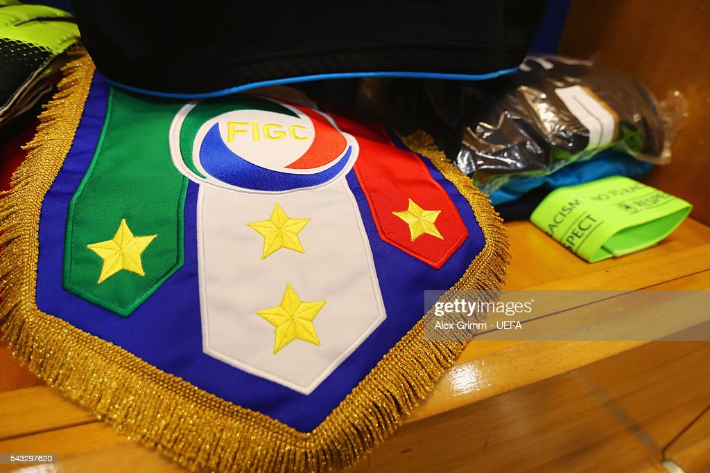 The captain's armband and the match pennant are seen in the dressing room prior to the UEFA EURO 2016 round of 16 match between Italy and Spain at Stade de France on June 27, 2016 in Paris, France.