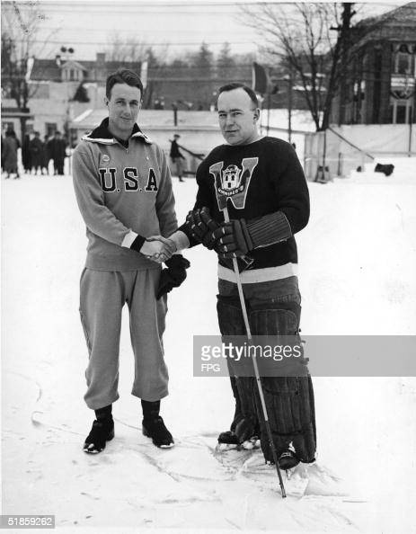 The captains of the American and Canadian Olympic ice hockey teams John Chase of the USA and William Cockburn of Canada shake hands as their teams...