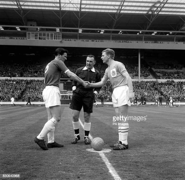 The captains of Wimbledon and Sutton United shakes hands before the start of the FA Amateur Cup at Wembley Stadium London Final Score Wimbledon 4...