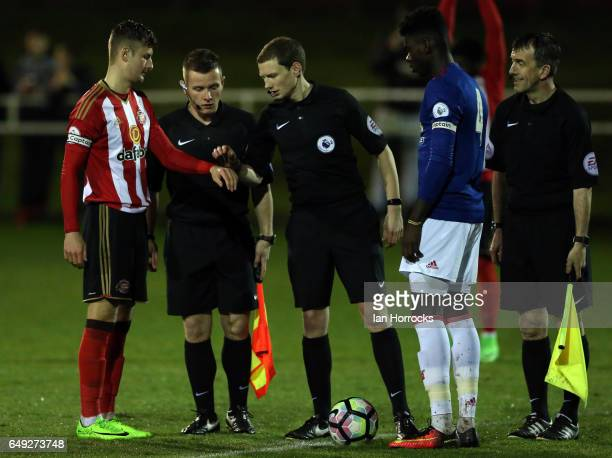 The captains toss up during the Premier League 2 match between Sunderland U23 and Manchester United U23 at the Hetton Centre on March 6 2017 in...