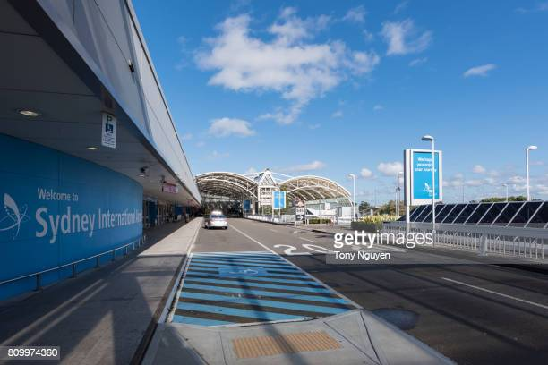 Sydney, Australia - June 13, 2017: The car dropping off people in front of departure area of Sydney International Airport in a sunny day.