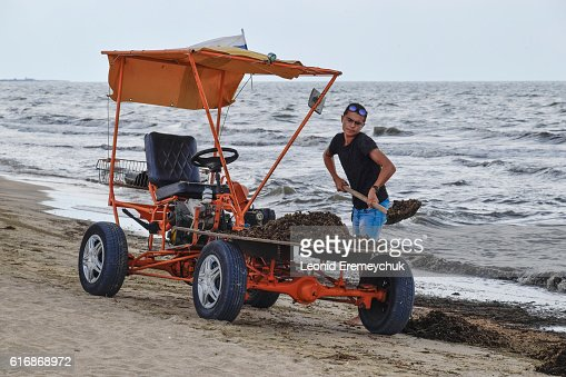 The car for garbage collection from the beach : Stock Photo