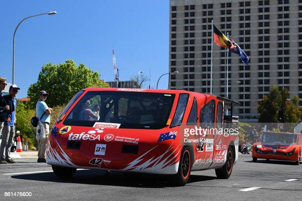 SAV the car from Australia's TAFE SA competes during a street parade for the 2017 Bridgestone World Solar Challenge down Wakefield Street in Adelaide...