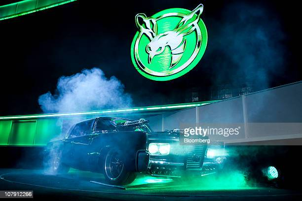 The car from the 3D movie 'The Green Hornet' arrives carrying Howard Stringer chairman and chief executive officer of Sony Corp and actors Seth Rogen...