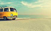 A yellow car on the sandy beach. This is a 3d render illustration. The car is a generic model.
